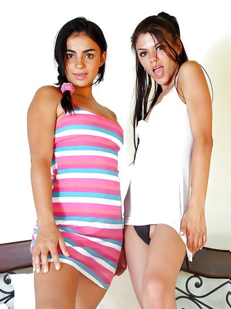 Stunning teen lesbians stripping and caressing...