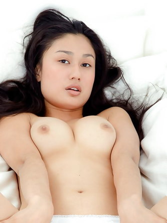 Sexy Asian with perky tits poses naked to expose...